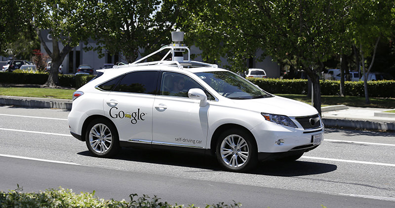 In this May 13, 2014 file photo, a Google self-driving car goes on a test drive near the Computer History Museum in Mountain View, Calif. (AP Photo)