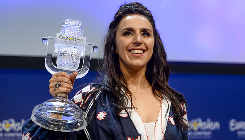 Ukraine's Jamala smiles as she shows her trophy at a press conference after winning the 2016 Eurovision Song Contest final at the Ericsson Globe Arena in Stockholm, Sweden, Sunday, May 15, 2016 (AP Photo)