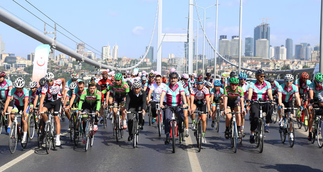 Cyclists ride over the 1.6 kilometer long Bosporus Bridge, the last stopover of their ride that took them from Austria to Turkey.
