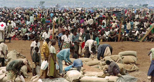 This file photo taken on May 20, 1994 shows some 90,000 Rwandan refugees waiting to get food from the Red Cross in the Benako, Tanzania refugee camp AFP Photo