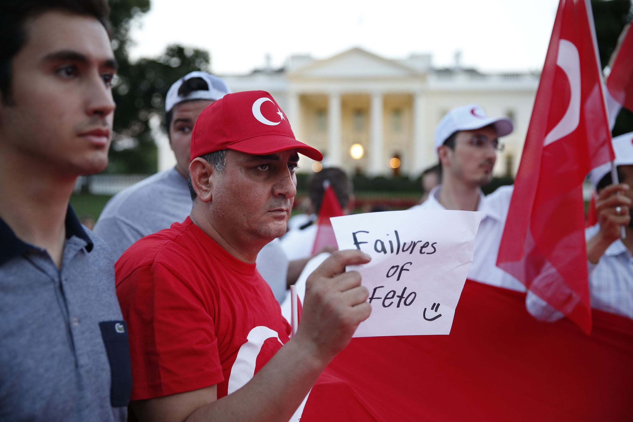 Protesters holding Turkish national flags rally at the Pennsylvania Avenue in opposition to the ongoing attempted coup in Turkey in front of the White House in Washington, DC, USA, 15 July 2016.