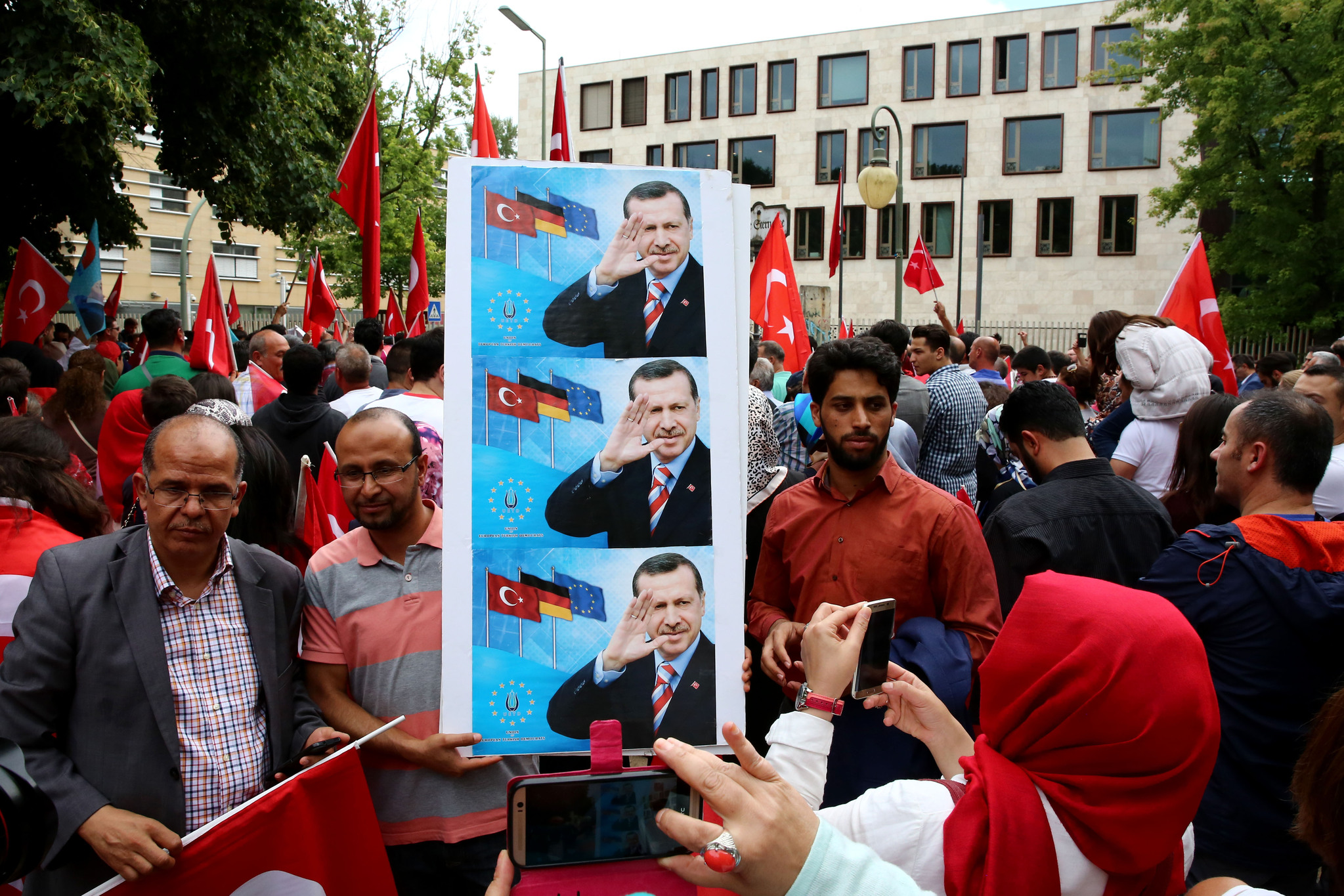 Demonstrators with Turkish flags at a demonstration against the failed attempted coup in Turkey, outside the Turkish embassy in Berlin, Germany, 16 July 2016.
