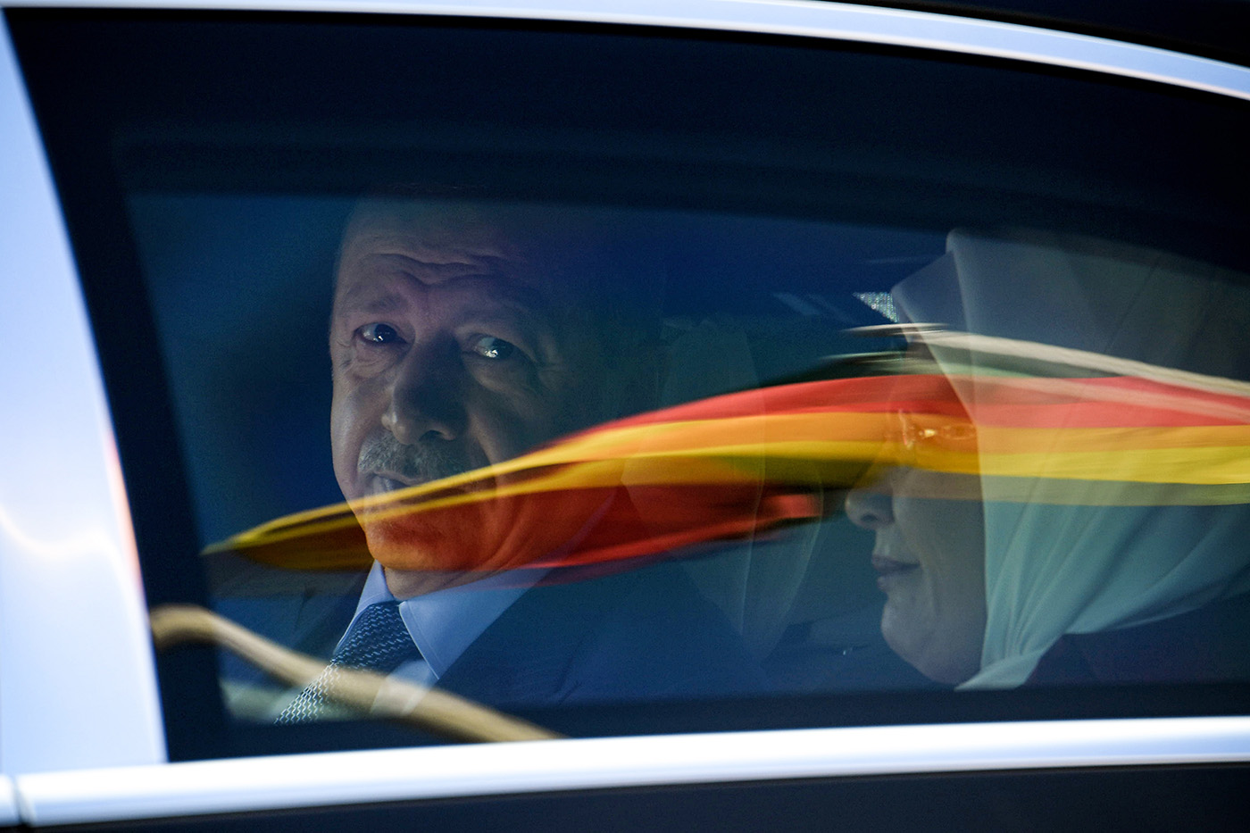 President Recep Tayyip Erdou011fan sits in a car behind a reflection of the German flag as he departs after his arrival from the Berlin Tegel Airport for an official visit in Berlin, Germany, 27 September 2018. (EPA Photo)