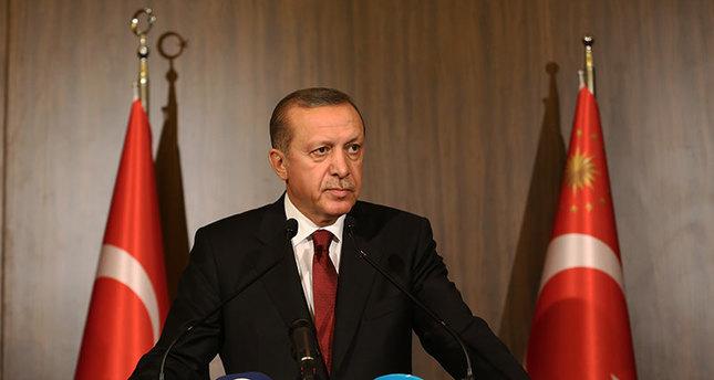 أردوغان وداود أوغلو يدينان الاعتداءات الإرهابية بباريس