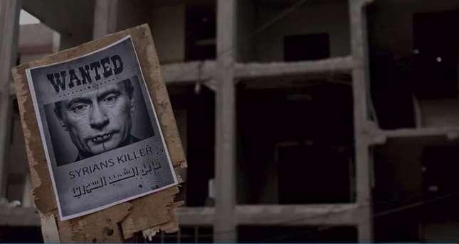 لافتات  بوتين قاتل السوريين في شوارع دمشق معقل نظام الأسد