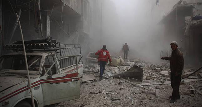 صورة تظهر آثار الدمار الناجم عن غارات النظام السوري على مدينة دوما ، 13 ديسمبر   (وكالة الأنباء الفرنسية)
