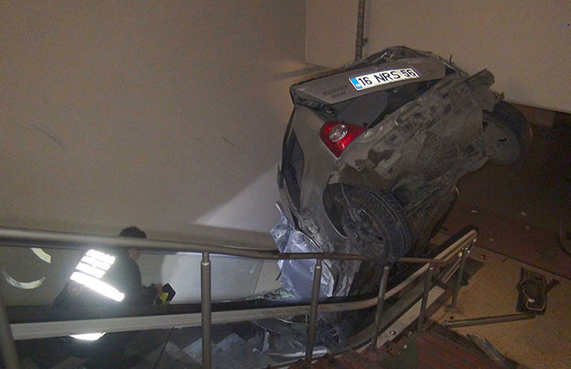 Car lands on metro escalator after accident in Bursa. (DHA Photo)