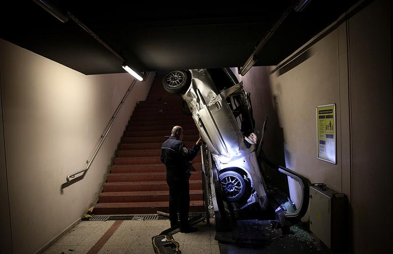 Car lands on metro escalators after accident in Bursa. (AA Photo)