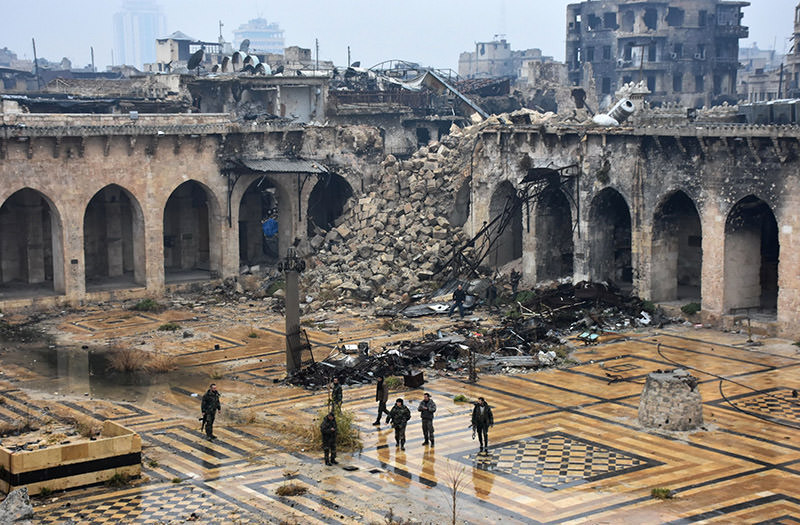 A general view shows Assad regime forces walking in the ancient Umayyad mosque in the old city of Aleppo on Dec. 13, 2016. (AFP Photo)