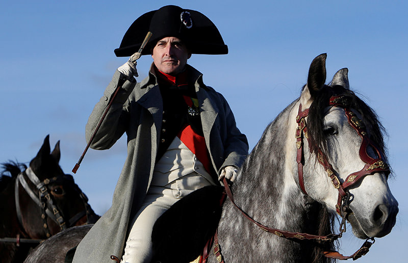 An actor, dressed as French Emperor Napoleon I, rides his horse before the re-enactment of Napoleon's famous battle of Austerlitz. (Reuters Photo)