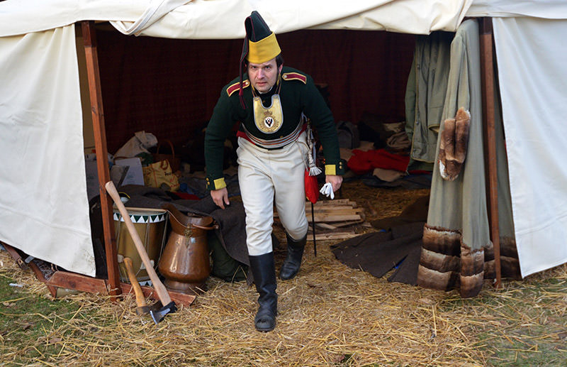 Historical re-enactment enthusiast dressed as a soldier leaves his tent on December 03, 2016 in Tvarozna prior a re-enactment of Napoleon's famous battle of Austerlitz. (AFP Photo)