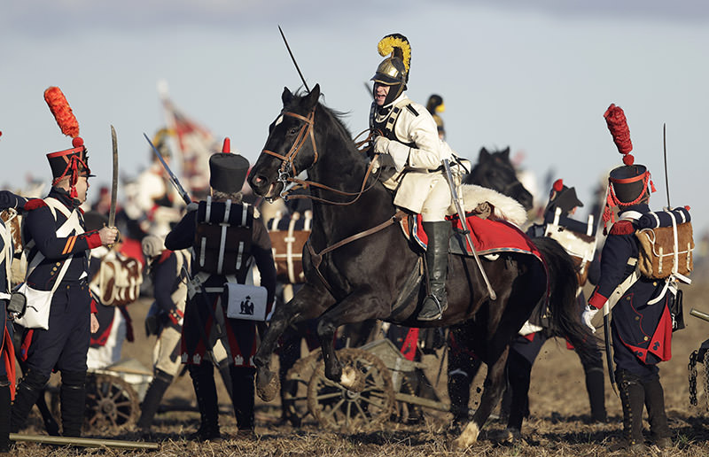 History enthusiasts dressed in regimental costumes take part in a re-enactment of the battle of Austerlitz. (AP Photo)