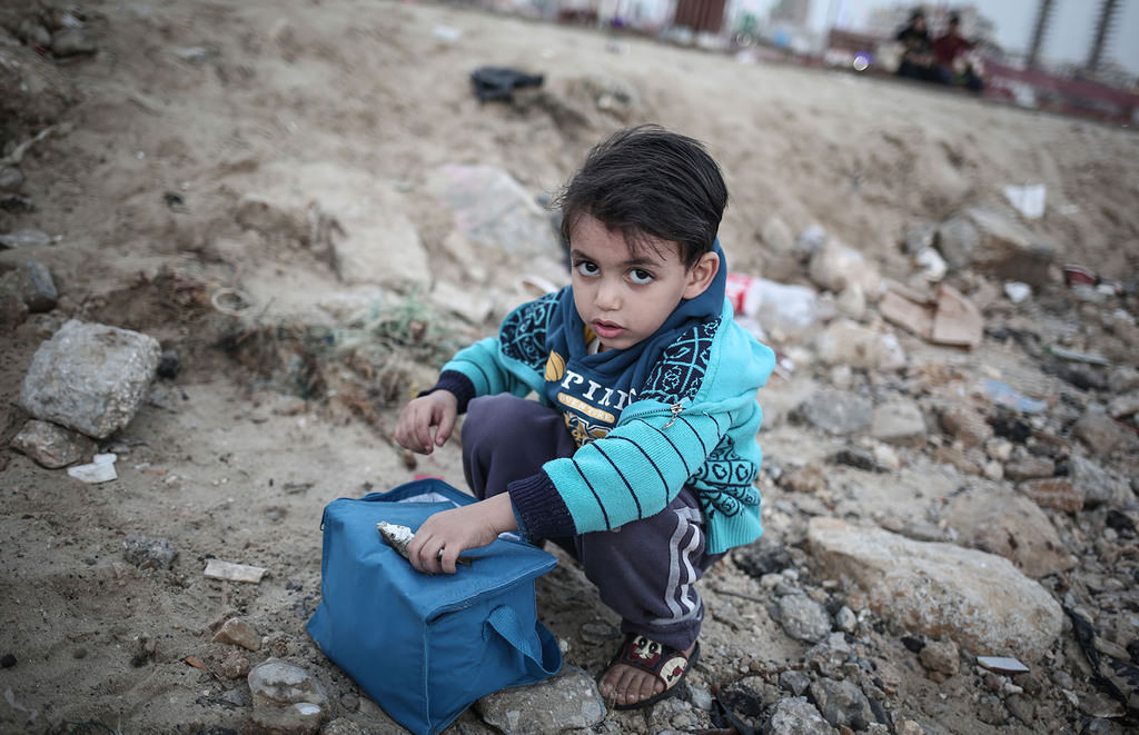 Thousands of Palestinian children are affected by hard living conditions at the Gaza Strip. (AA Photo)