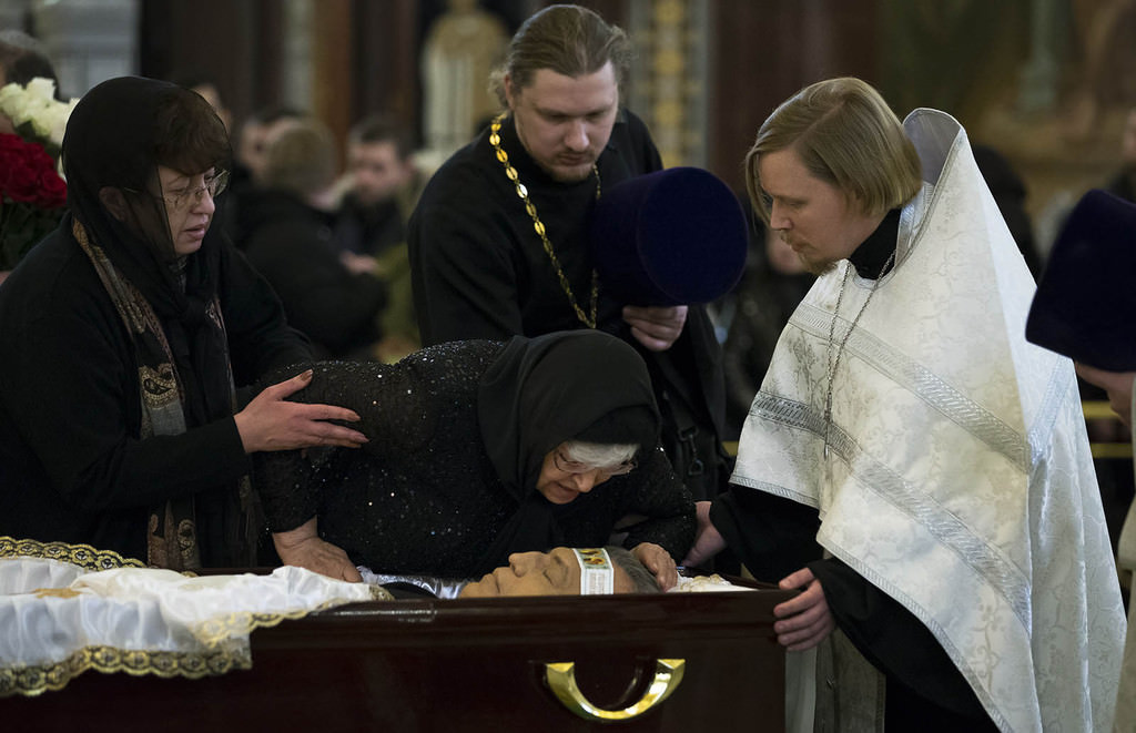 Mother of Andrei Karlov, Maria, right, kisses her son during a religious service for killed Russian ambassador to Turkey, Andrei Karlov inside the Christ the Saviour Cathedral in Moscow