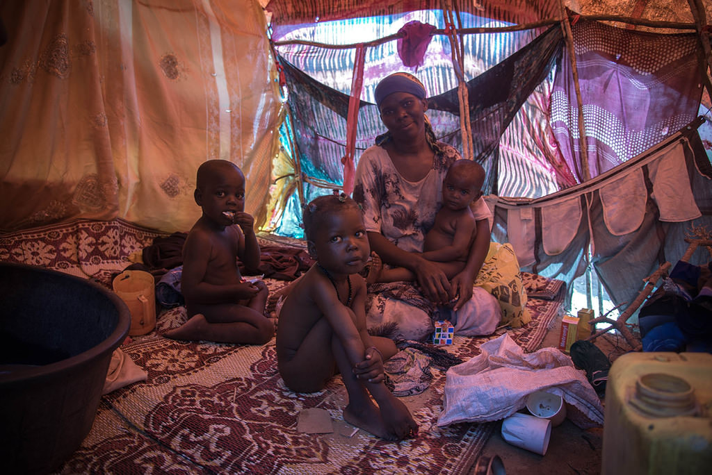 Amina Sharif Muhammad, who lost her husband on the way to Mogadishu, struggles to survive with her four children in a tent camp.