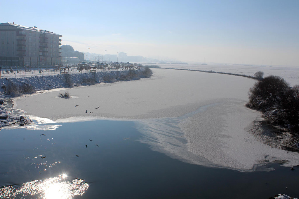 u00c7u0131ldu0131r Lake in Ardahan is covered with ice due to freezing temperatures. (DHA Photo)