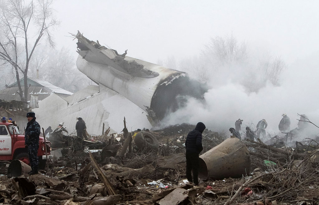 Rescue teams are seen at the crash site of a Turkish cargo jet near Kyrgyzstan's Manas airport outside Bishkek, January 16, 2017. (Reuters Photo)