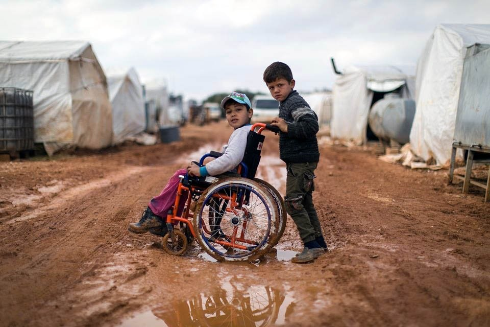 Syrian children displaced by the nine-year war in their country, struggle to survive under dire humanitarian conditions in overcrowded tent cities, Feb. 24, 2020 (DHA Photo)