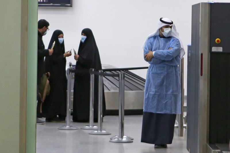 People coming back from Iran wait before being taken to a hospital to be tested for coronavirus, at Sheikh Saad Airport in Kuwait City, Kuwait, Feb. 22, 2020. (AFP Photo)