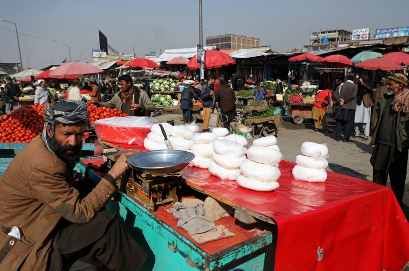 A man selling cheese waits for customers in Kabul, Afghanistan, Feb. 22, 2020. (Reuters Photo)