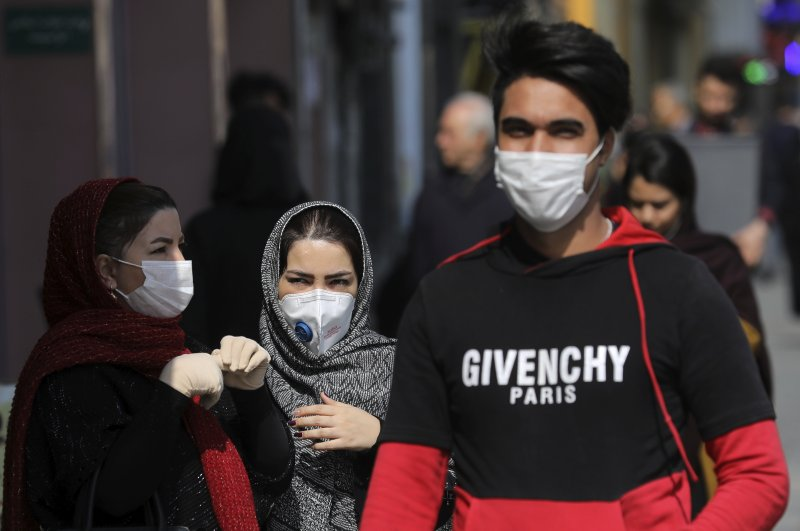 Pedestrians wear masks to help guard against the coronavirus, in downtown Tehran, Iran, Sunday, Feb. 23, 2020. (AP Photo)