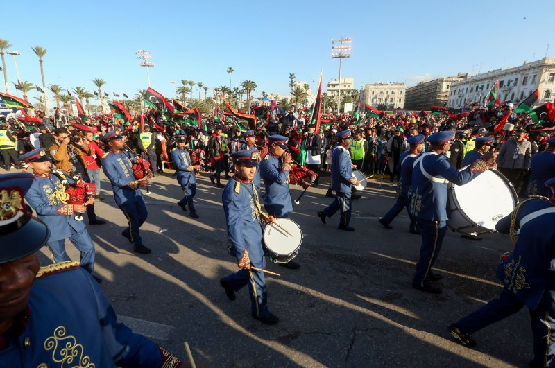 A Libyan marching band performs during a gathering to commemorate the ninth anniversary of the uprising against former Libyan leader Moamer Kadhafi, in the capital Tripoli on February 17, 2020. (AFP Photo)
