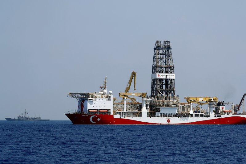 The drilling vessel Yavuz is escorted by the Turkish Navy frigate TCG Gemlik (F-492) in the Eastern Mediterranean off Cyprus, Aug. 6, 2019. (Reuters Photo)