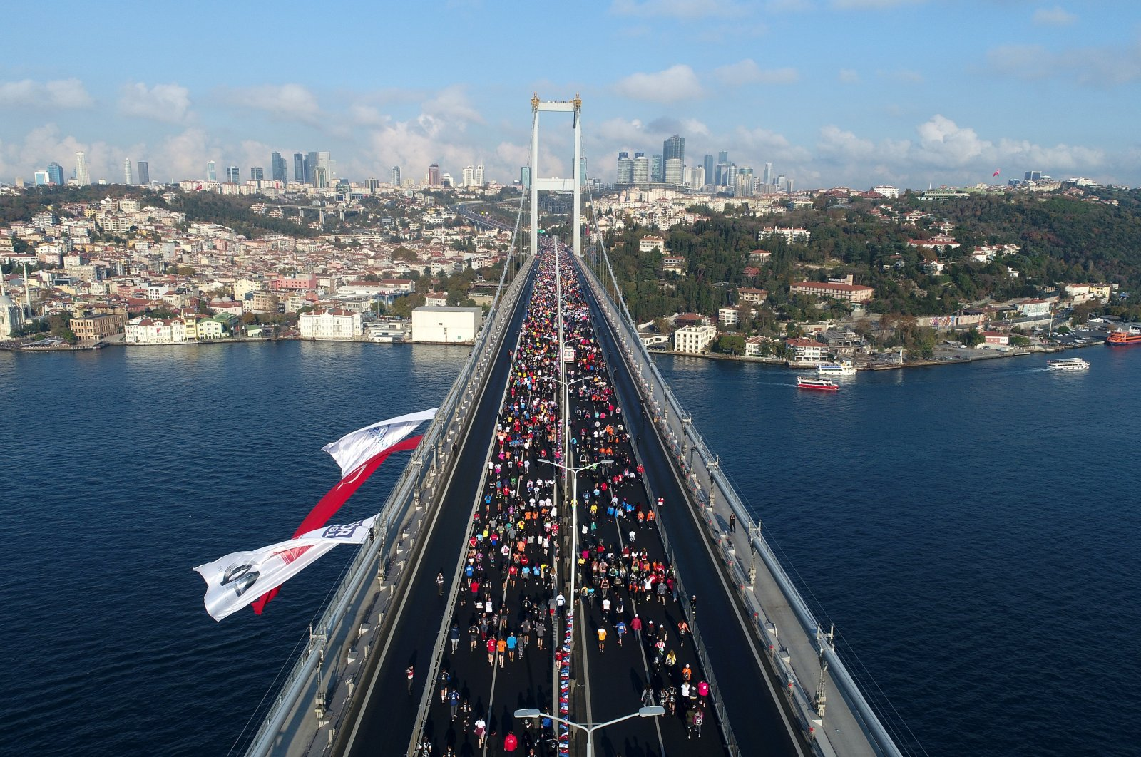 Runners cross the July 15 Martyrs' Bridge, formerly known as the Bosphorus Bridge, every year at the annual Istanbul Marathon. (IHA Photo)