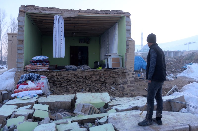A man looks at a house whose wall collapsed in the earthquake in Özpınar village, Van, Feb. 24, 2020. (İHA Photo)