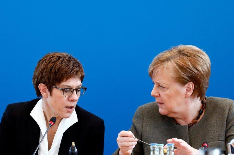 German Chancellor Angela Merkel and German Defense Minister Annegret Kramp-Karrenbauer speak during a CDU board meeting at the party's headquarters, Berlin, Feb. 24, 2020. (REUTERS Photo)