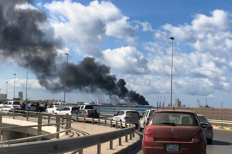Smoke rises from a port of Tripoli after being attacked by putschist Gen. Khalifa Haftar's forces, Feb. 18, 2020. (REUTERS)