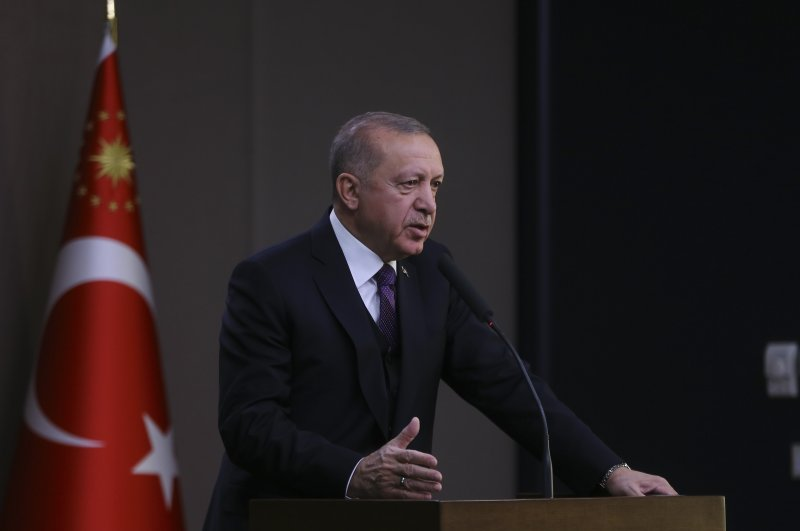 President Recep Tayyip Erdoğan speaks to reporters at Esenboğa Airport ahead of his departure for an official trip to Azerbaijan, Feb. 25, 2020 (AA Photo)