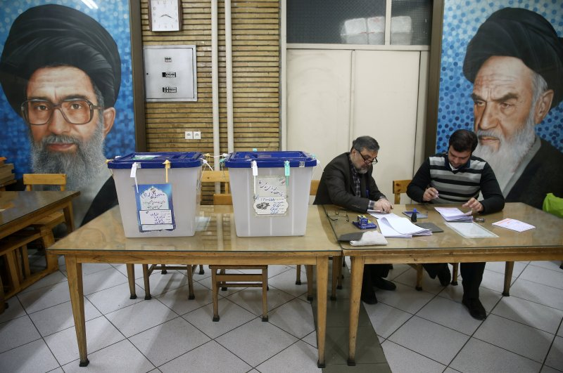 Polling officers are seen at a polling station during the Iranian parliamentary elections, Tehran, Feb. 21, 2020. (REUTERS Photo)