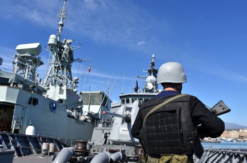 The Turkish Navy's TCG Salihreis frigate waits at Catania port in Sicily to take part in the NATO drill. (AA Photo)