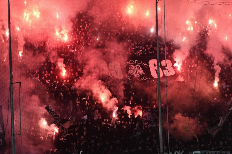 PAOK fans burn flares during the Greek Super League match between PAOK Thessaloniki and Olympiakos Piraeus at the Toumba Stadium in Thessaloniki, Greece, Feb. 23, 2020. (AFP Photo)
