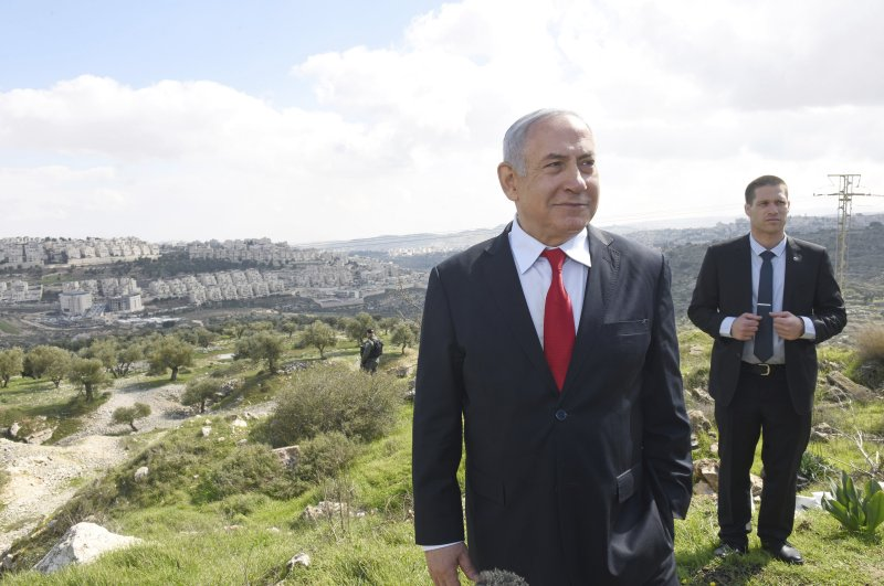 Israeli Prime Minister Benjamin Netanyahu stands at an overview of the West Bank Israeli settlement of Har Homa, Feb. 20, 2020. (AP Photo)