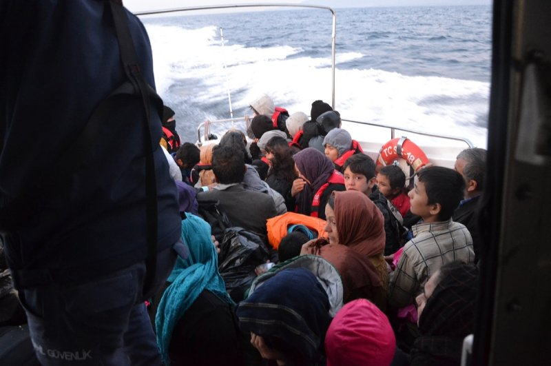 Illegal migrants stopped off the coast of Ayvacık in a Coast Guard Command boat, Çanakkale, Dec. 2, 2019. (DHA Photo)