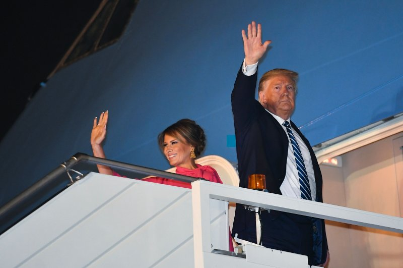 U.S. President Donald Trump and First Lady Melania Trump wave as they board Air Force One at Palam Air Force Airport in New Delhi on Feb. 25, 2020. (AFP Photo)