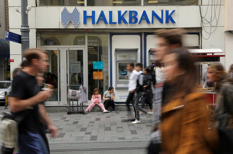 People walk past a branch of Halkbank in central Istanbul, Turkey, Oct. 16, 2019. (Reuters Photo)