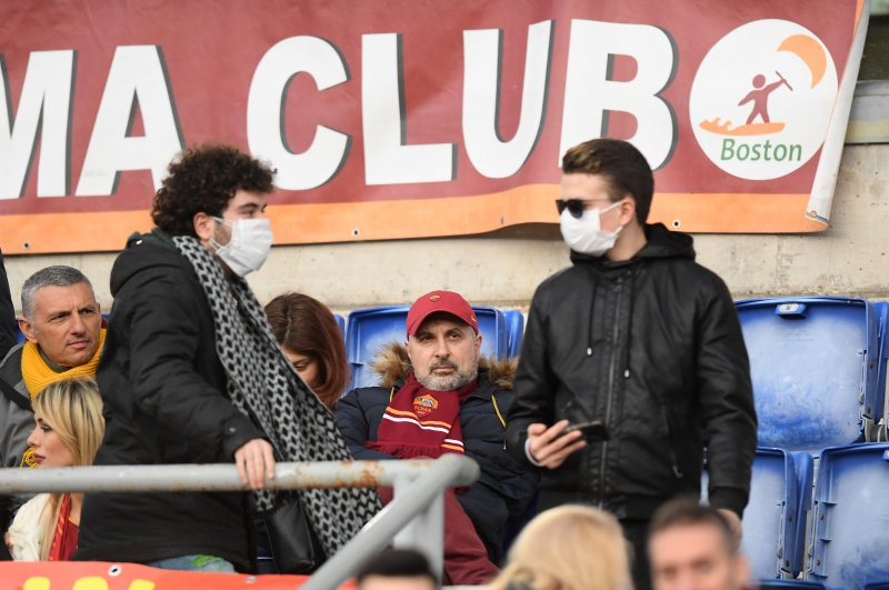 AS Roma fans wearing face masks inside the stadium before the match amid concern following a coronavirus outbreak in Italy, Feb. 23, 2020. (Reuters Photo)
