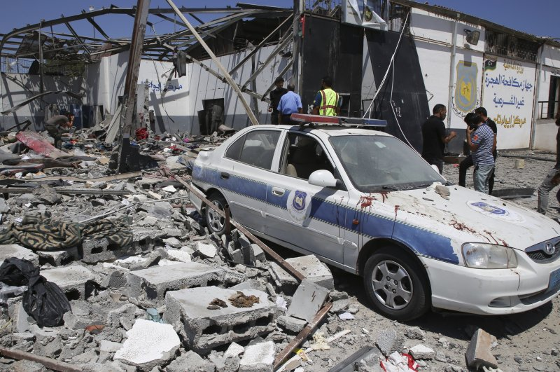 In this July 3, 2019, file photo, debris covers the ground and an emergency vehicle after an airstrike at a detention center in Tajoura, east of Tripoli in Libya. (AP Photo)