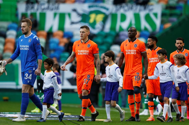 Istanbul Başakşehir enters the pitch prior to the Europa League round of 32 first-leg football match against Sporting CP at the Alvalade stadium in Lisbon, Thursday, Feb. 20, 2020. (Reuters Photo)