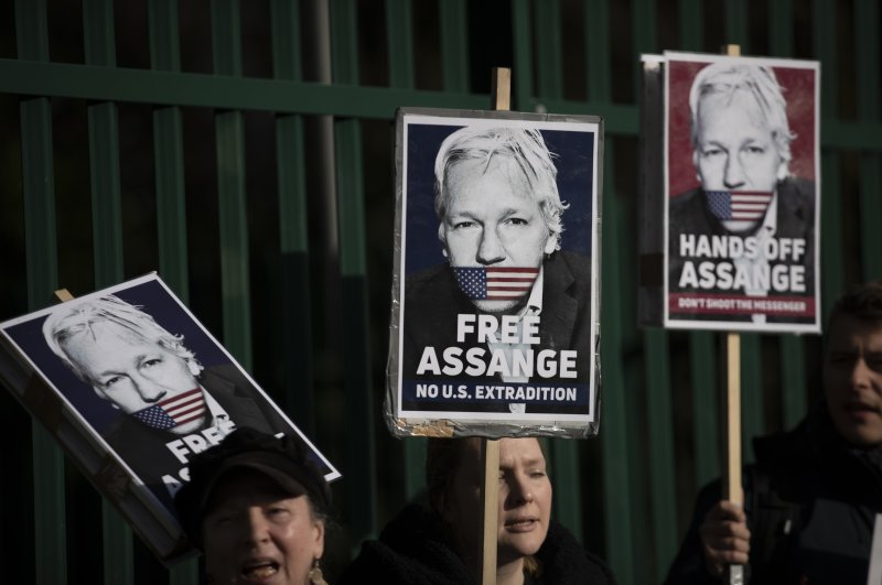 Supporters of Julian Assange hold placards outside Belmarsh Magistrates' Court in southeast London, Feb. 25, 2020. (AP Photo)