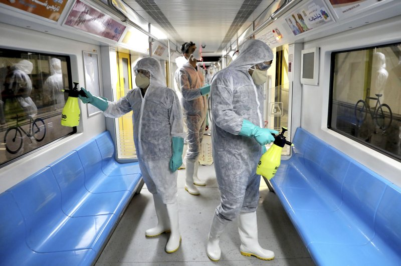 Workers disinfect subway trains against coronavirus in Tehran, Iran, in the early morning of Wednesday, Feb. 26, 2020. (AP Photo)