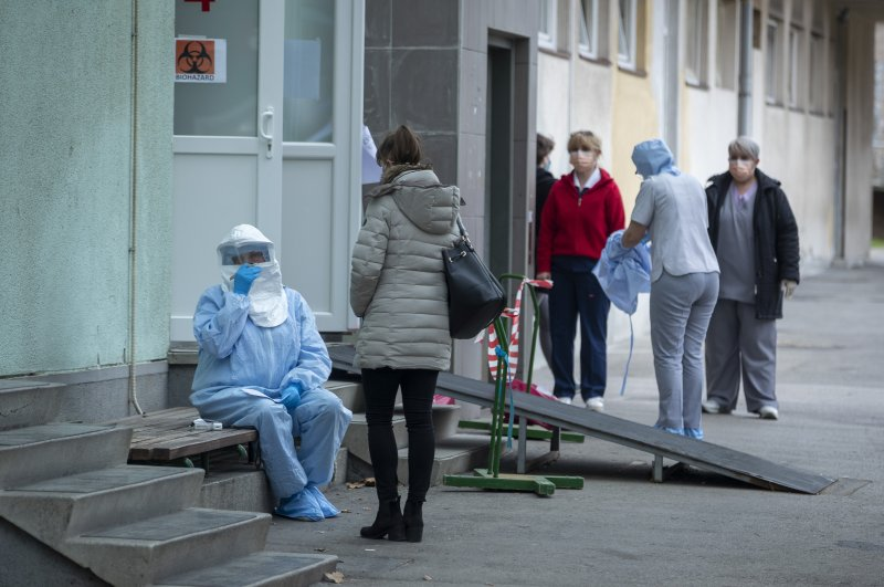 A health worker takes notes at an infectious disease clinic, Zagreb, Feb. 25, 2020. (AP Photo)