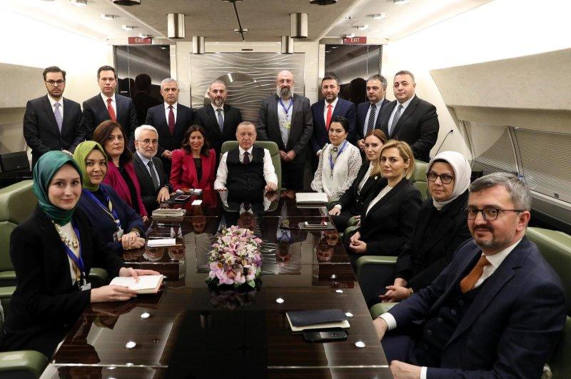 President Recep Tayyip Erdoğan on presidential plane from Baku with journalists including Daily Sabah Ankara Representative Nur Özkan Erbay, Feb.25, 2020 (DHA Photo)
