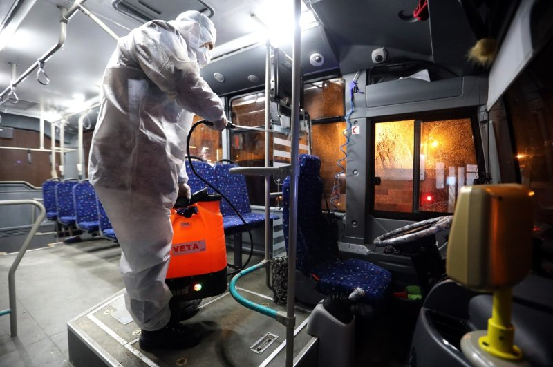 A municipality worker disinfects a bus against virus risk in the eastern Turkish city of Van, which borders Iran, Feb. 26, 2020. (AA Photo)
