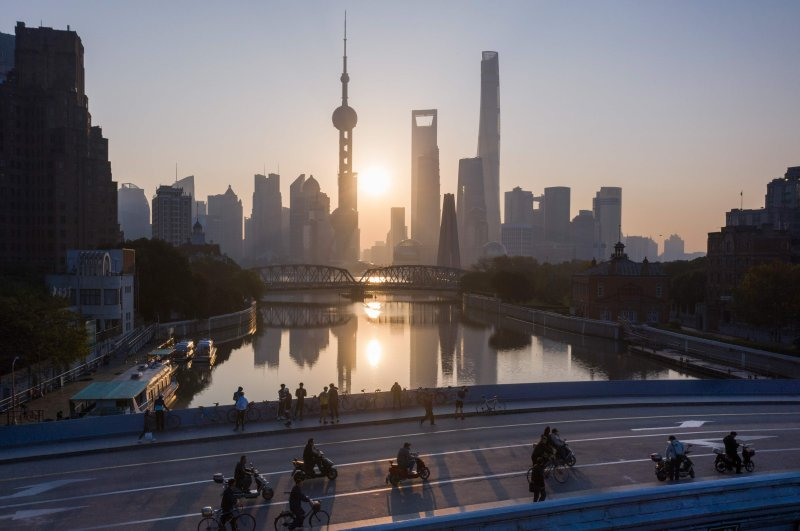 This aerial picture shows the sun rising behind the skyline of Shanghai's Lujiazui financial district of Pudong, Nov. 13, 2018. (AFP File Photo)