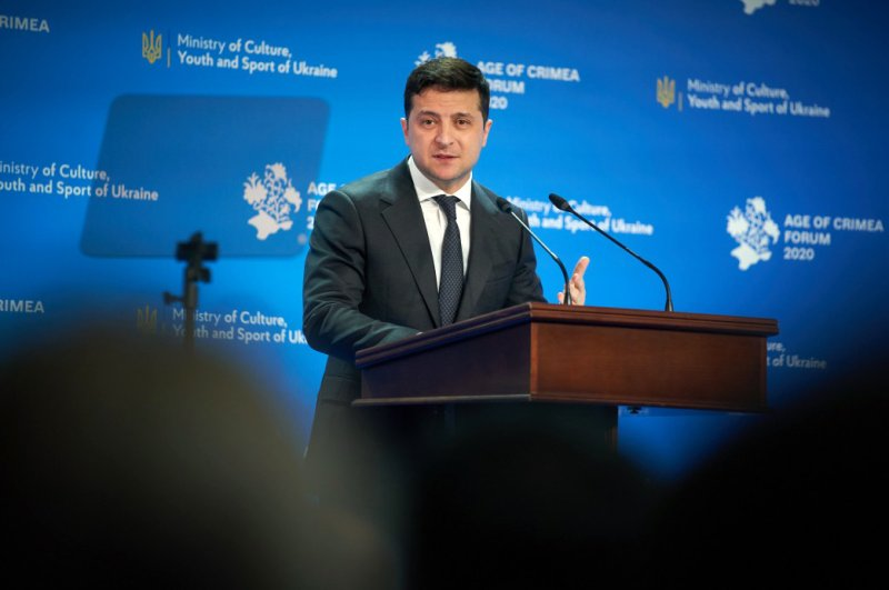 """This handout picture was taken and released by the Ukrainian presidential press service showing President Volodymyr Zelensky delivering a speech during a forum titled """"Age of Crimea"""" in Kyiv, Feb. 26, 2020. (Photo by Handout)"""