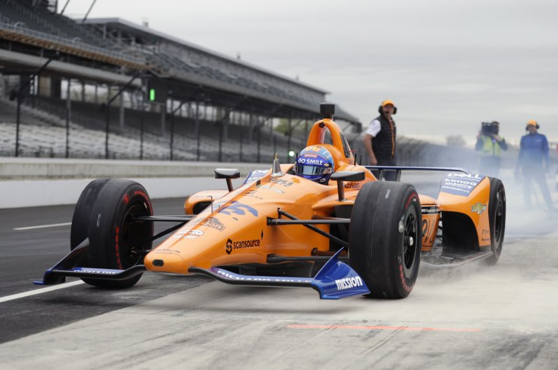 IndyCar driver Fernando Alonso, of Spain, drives out of the pit area during testing at the Indianapolis Motor Speedway in Indianapolis. Alonso will once again attempt to complete motorsports' version of the Triple Crown with a return to the Indianapolis 500 in May with McLaren. (AP Photo/Michael Conroy, File)